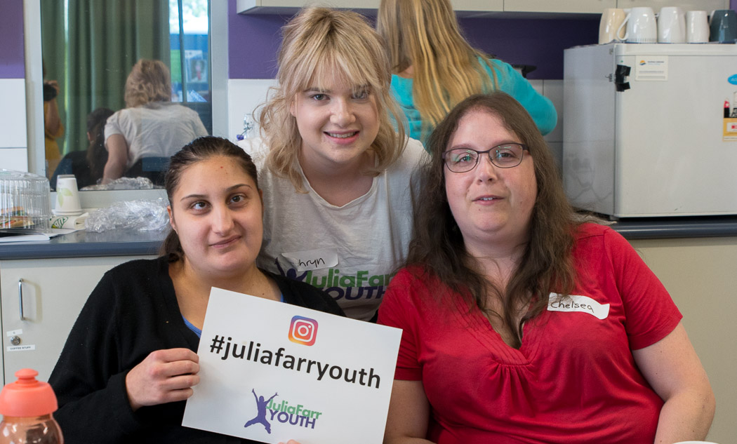 Three members holding a sign that says #JuliaFarrYouth